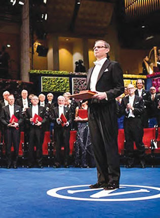 Jean Tirole receiving his Nobel Prize in 2014 | Source